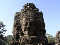 Bayon Temple, Angkor Wat, Cambodia  At the very center of Angkor Thom, the distinctive Bayon is one of the few originally Mahayana Buddhist temples and the last state temple to be built in Angkor. LocationNorth of Angkor Wat and facing the east, the temple is located at Angkor Thom's center, with broad roads connecting it to the city's gates. Its location at the downtown area center hints at is importance.DedicationThe Bayon was built by King Jayavarman VII and dedicated to the Buddha