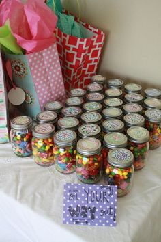 Great idea for baby shower favors! Add candy to mason jars for a treat guests can take on their way out.
