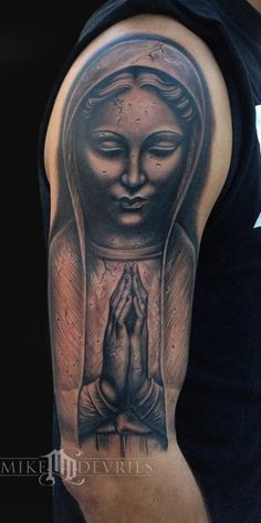 Madonna Statue inked by one of the worlds best tattoo artists, Mike DeVries.   http://www.mdtattoos.com