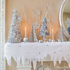 Wow Winter Wonderland Decorating Ideas - Party City-CUT POINTS ON SNOW BLANKET, ADD SILVER & BLUE CONFETTI, METALLIC TREES, SNOWFLAKES GLITTERED TWIGS