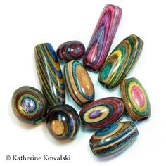 Dreadlock 10 Bead Set C - Wooden Focal Beads - Dyed Hardwood - all DIFFERENT colors (DAYSTAR) Katherine Kowalski woodturning. $80.00, via Etsy.