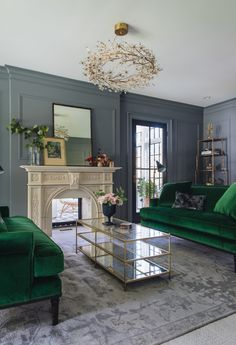 elegant living room design with marble fireplace and dark gray panel walls with green velvet sofa, traditional living room decor by Jean Stoffer Design, contractor: Kenowa Builders, Grand Rapids builder, michigan remodeler Living Room Green, Living Room Decor, Living Rooms, Kitchen Living, Emerald Green Sofa, Casa Milano, Green Velvet Sofa, Green Couches, Appartement Design