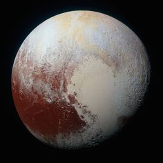 2015 gave us Earth's first ever high-resolution photo of Pluto: | The 22 Most Mesmerizing Space Photos Of 2015