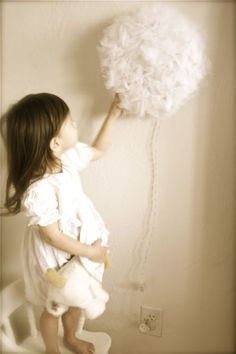 Make this fluffy cloud pom night light. | 41 Coolest Night Lights To Buy Or DIY