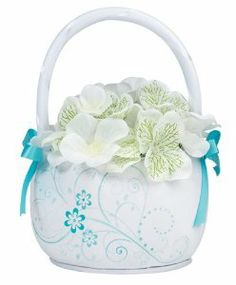 "Aqua Floral Flower Basket by Lillian Rose. $11.99. petals not included. Measuring 7"" tall and 5.125"" wide. Measuring 7"" tall and 5.125"" wide, this white satin flower basket is accented with two aqua ribbons and silkscreened with a stylish aqua floral/scroll pattern on front and back.  Also available in a pink version."