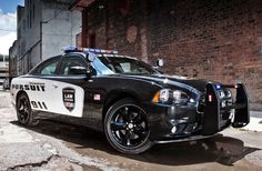 Chrysler detailed the updates for its now available 2014 Dodge Charger Pursuit sedan for law enforcement including changes to its drivetrain brakes exterior look and new police specific features such as Secure Park. 2012 Dodge Charger, Dodge Charger Price, Charger Srt, Porsche Carrera, Porsche Panamera, Police Humor, Police Officer, Probation Officer, Ford Motor Company