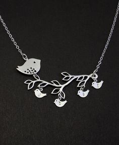 Lovely bird family necklace featuring mamma bird and 4 little ones (sample photo), each baby stamped with your choice of letters. You create a