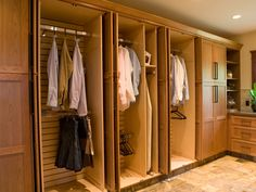 Custom cabinetry with full-height doors neatly encloses the clean clothes in this laundry room. Design by Shane Inman Organizing Walk In Closet, Laundry Closet, Laundry Rooms, Laundry Area, Mud Rooms, Family Closet, Master Bedroom Closet, Attic Closet, Hall Closet