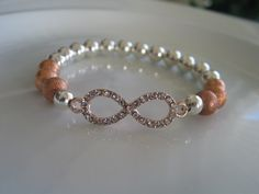 Rose pink gold toned/colored infinity charm by LeeliaDesigns, $13.00