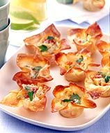 These Artichoke Tarts are so pretty. And not only do they sound tasty, but they're Weight Watchers-friendly! A lot of the reviews recommend trying it with shrimp... I think that will be my choice.