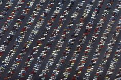 "The photography of Alex S. MacLean: ""I have this image of a parking lot in my home to remind me of the man-made structures, patterns, and topographies that dot our landscape, and what a substantial effect on our environment we have. MacLean flies around the United States in his plane and documents these landscapes. The views are extraordinary and remind me of the scale of man to the land."""