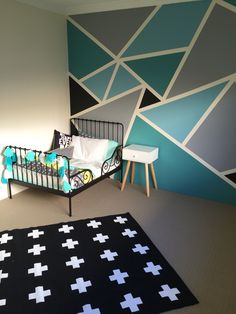 Big boys bedroom withal the IKEA minnen toddler bed frame, Adairs linen and a funky geometric wall paint job.
