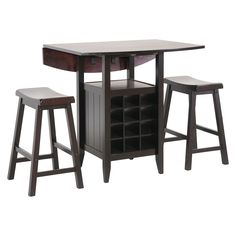 <p>Your breakfast nook will be changed for the better after you add our Reynolds Pub Set to your home. This casual, tall dining table features a two drop-leaf top supported by a centrally-positioned wine rack and shelf for additional storage or display of decor. Also included are two saddle stools, all of which are made of rubberwood and engineered wood with a black lacquer finish. The Reynolds Wine Cabinet is made in Malaysia and requires assembly. To clean, dust with a dry c...