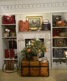 Rebecca Ray Booth...  Beautiful colors in the bags. Love the wood chest.