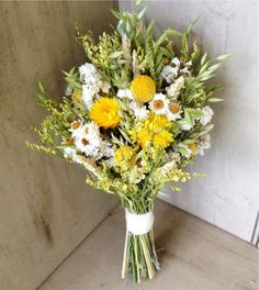 Simple fall bridal bouquet of Wheat, Craspedia and dried flowers for your autumn wedding.