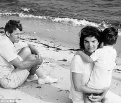 Jackie with her son John Jr and Bobby Kennedy in Hyannis Port, Cape Cod, in 1964