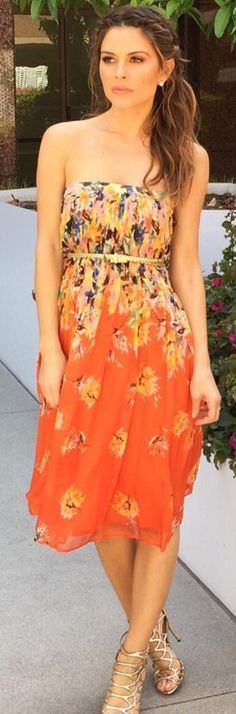Who made Maria Menounos' gold sandals and orange print strapless dress?