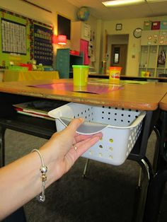 """Use baskets as """"drawers"""" in their desks. Students put their pencil pouch and any """"loose"""" tools in there to keep their desk nice and tidy. Wonder if Ella's teacher would let me implement this? Her desk is always a disaster zone."""