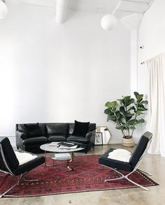 midcentury modern furniture in a white loft space with vintage rug