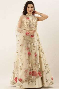 Exhibiting elegant embroidery and stitch detailing, this cream beige satin silk lehenga which will make you ready to make a statement on the upcoming occasion. This halter neck and sleeveless party wear blouse decorated using thread work. Completed with satin silk a-line style lehenga in cream beige color with cream beige net dupatta. A-line style lehenga has thread work. #lehengacholi #usa #Indianwear #Indiandresses #andaazfashion Lehenga Choli Latest, Lehenga Choli Online, Bridal Lehenga Choli, Silk Lehenga, Silk Dupatta, Plus Size Lehenga, Lehenga Indien, Party Wear Lehenga, Lehenga Designs