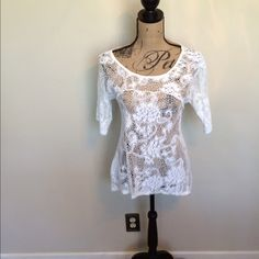 High low lace top  you are not alone lace top  Size medium  NWOT  white  Please ask for additional pictures, measurements, or ask questions before purchase.  No trades or other apps  Ships next business day, unless noted in my closet   Bundle for discount You are not alone Tops