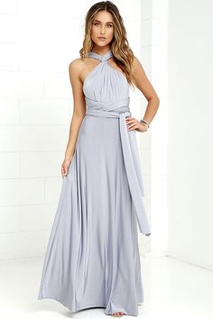 """Any which way you wrap it, the Always Stunning Convertible Light Grey Maxi Dress is one amazing dress! Two, 82"""" long lengths of fabric sprout from an elastic waistband and wrap into dozens of possible bodice styles including halter, one-shoulder, cross-front, strapless, and more. Stretchy light grey fabric has a satiny sheen, and a full length maxi skirt pairs perfectly with any choice you make up top. Want Styling Tips? <a href='http://bit.ly/HowToWearIt' target='_blank'>See How To Wear…"""