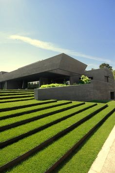 Concrete house in Pozuelo de Alorcón, Spain by A-cero and Joaquin Torres Architects...for the grass terraces
