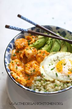 A delicious Paleo-Whole 30 Spicy Shrimp Cauliflower Rice Bowl with fried egg and avocado made in 15 minutes!