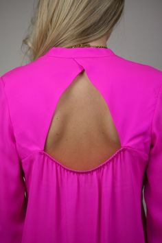Pink blouse with cute open back.