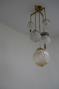 Love this cobbled together vintage glass light fixture. It's awesome.