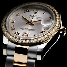 Rolex - Classic goes with all my outfits and not so heavy on the hand:)