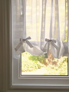 a clever curtain trick:  pressure rod at top, dowel rod in pocket at bottom, tied up with ribbons to desired view; functional AND pretty and includes DIY instructions