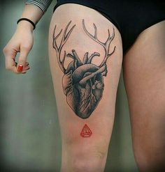 Anatomical heart and antlers tattoo