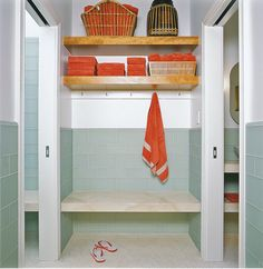 Towel hooks and shelving for wall across laundry door