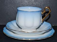 RARE ROYAL ALBERT CHINA BLUE  RAINBOW  HARLEQUIN TRIO TEA CUP SAUCER SIDE PLATE