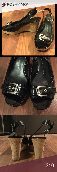 Franco Sarto 9.5 black/cork wedges with buckles Franco Sarto 9.5 black/cork wedges with buckles. Only worn a couple times. Would make a great summer wedding shoe. Franco Sarto Shoes Wedges