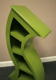 I love this shelf...such an interesting design.  Reminds me of something out of a Dr. Suess illustration!  Very different!