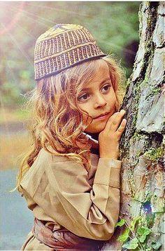 A Kurdish Girl in traditional Boy's Clothing.