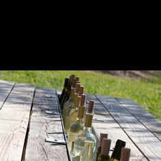 Remove a board from a picnic table and replace with a gutter: a picnic bar!!!--heck yes!!  I would do this!  Future idea! hahab