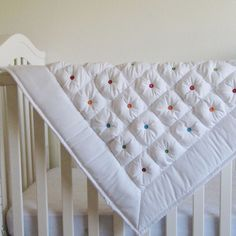 """great idea for quilt- colorful buttons ( use felt """"buttons"""" if making for baby). Minky on the back"""