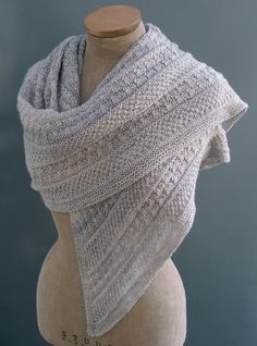 This highly textured shawl was inspired by the many lichens and mosses that grow in Wales. Lichen stitch is paired with moss stitch bands, which are accentuated by reverse stocking stitch. These contrast with the wide central garter stitch panel. It is worked top down and is an interesting, yet easy knit for the advanced beginner. A versatile shawl in 2 sizes, that can be worked in a variety of yarns from 4ply (fingering) through to worsted (aran) weight.Fingering (4ply) weight yarn…