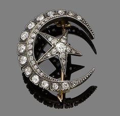 A diamond crescent and star brooch, circa 1900 Designed as a crescent set with a graduating row of old brilliant-cut diamonds, flanked by single-cut diamonds, enclosing a similarly-set five-rayed star, mounted in silver and gold, diamonds approx. 2.45ct total, length 3.5cm, fitted case by Garring & Co, 130 Regent Street
