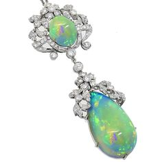 14k White Gold Opal and Diamond Pendant inspired from the Edwardian period.
