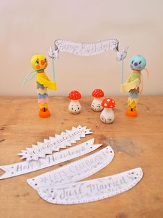Cake topper table centrepiece birds holding mini banner celebration