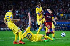 Luis Suarez of FC Barcelona shoots towards goal under a challenge by Nemanja Milunovic (2ndL) of FC BATE Borisov during the UEFA Champions League Group E match between FC Barcelona and FC BATE Borisov at the Camp Nou on November 4, 2015 in Barcelona, Catalonia.
