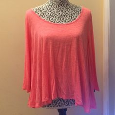 Pink criss cross back top Super flowy in a hot pinky coral color. The back has a criss cross detail that is super in trend right now! Great condition. Sleeves are a little past the elbows American Eagle Outfitters Tops