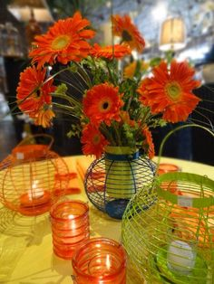 A summer tablescape for our Summer Open House a few weekends ago. Fresh Gerber Daisys paired with bright colors give a fun playful look! Hurry in, these metal colored lanterns are now 35% off!
