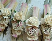 Shabby Chic Ivory decorative clothes pins Set of 8 clothing pegs with handmade paper flowers cottage chic cream. $18.00, via Etsy.