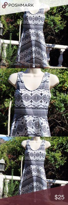 Black and white short summer dress Cute Black and white patterned, round neck, sleeveless, short dress. 32 inch length. Lightweight, synthetic blend fabric, great for summer! New with tags. Size 2. Bust.- 31inch. Waist- 29inch Byebye Dresses Mini