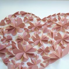 hearts cut and folded in half.  3D art.